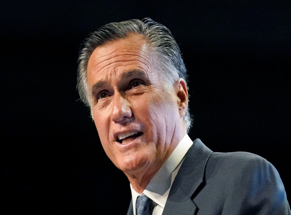 <p>Mitt Romney responds to booing at a Republican convention in Utah</p>