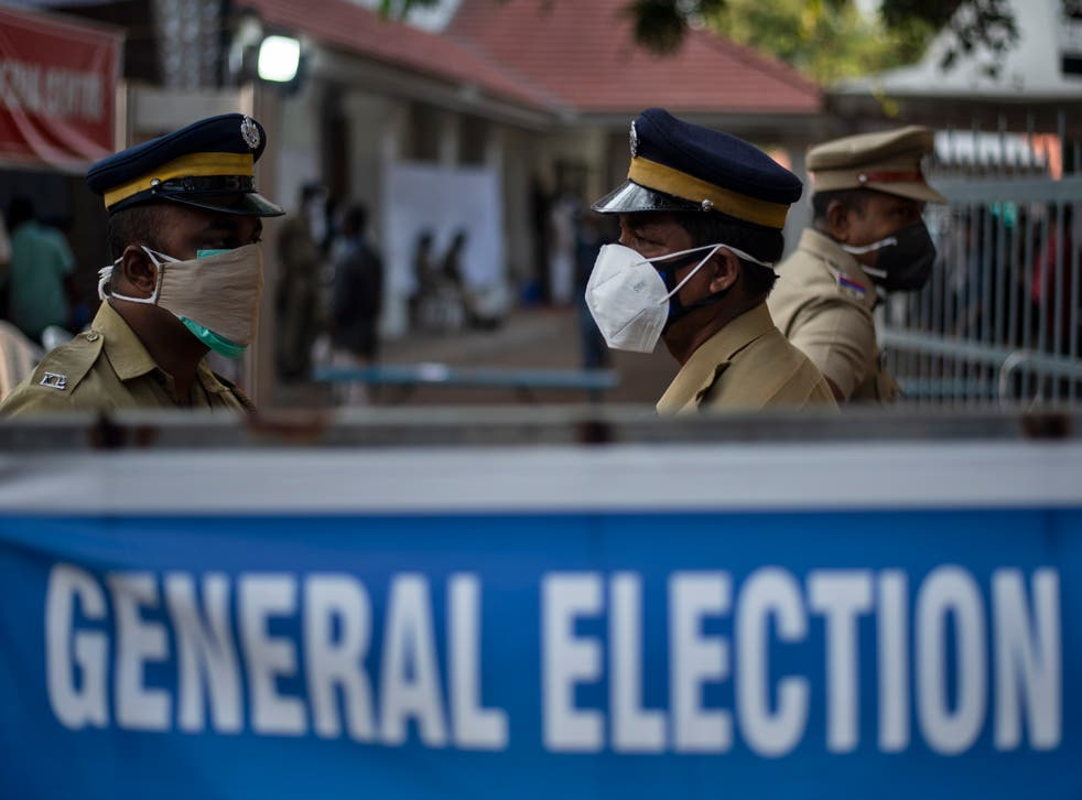 <p>Police guard a vote-counting centre for the state legislature elections during a weekend lockdown in Kerala</p>