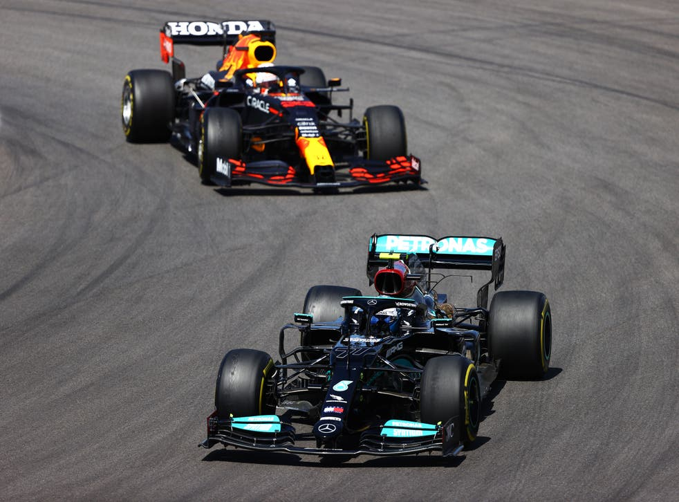 Max Verstappen (left) finished second as Valtteri Bottas came third
