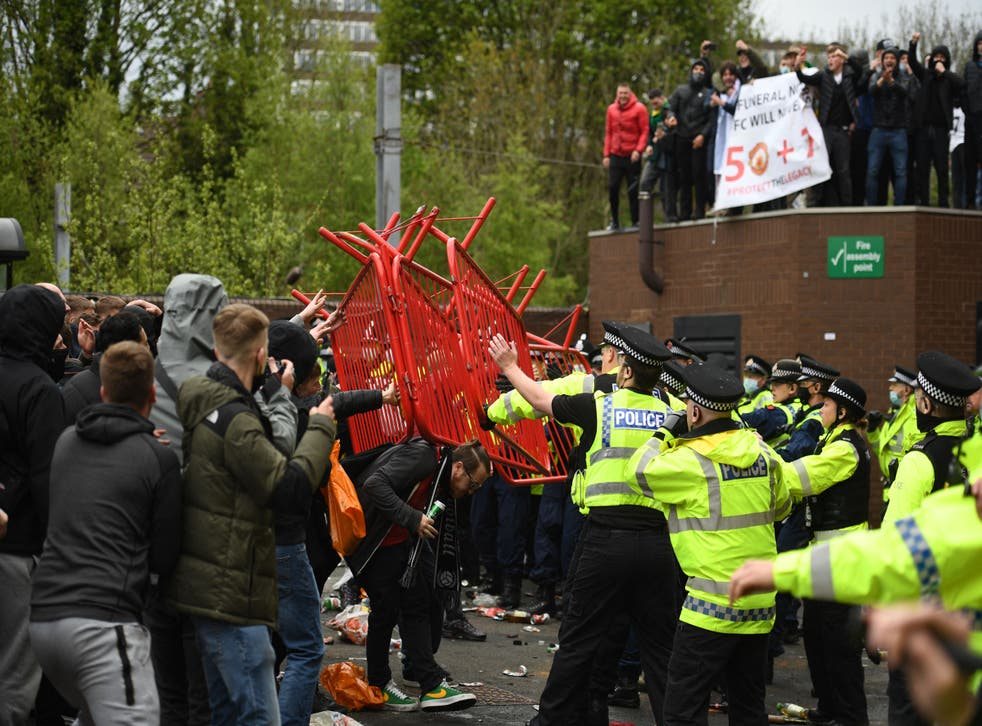 <p>Police clashed with supporters outside Old Trafford</p>