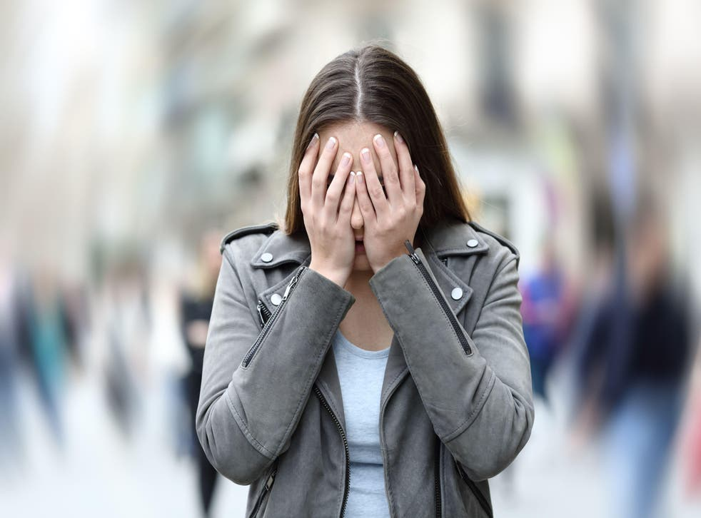 Woman suffering social anxiety