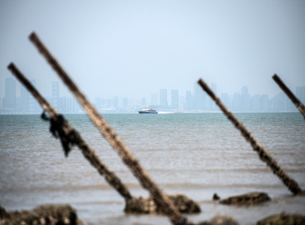 <p>A boat ferrying passengers between China and Taiwan seen behind anti-landing barricades on a beach on the Taiwanese island of Kinmen on 19 April, 2018.</p>