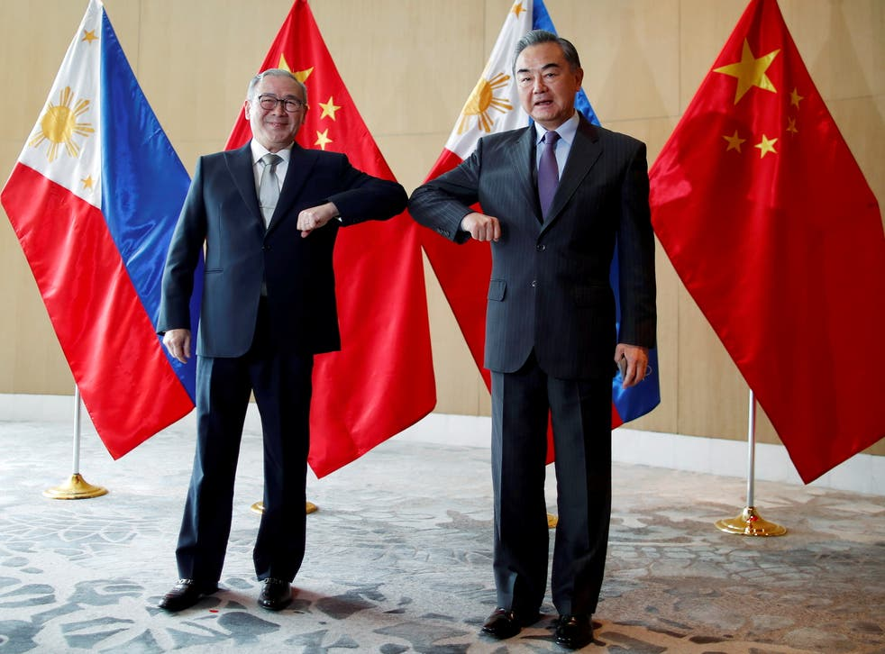 <p>File image: China's Foreign Minister Wang Yi and Philippine's Foreign Affairs Secretary Teodoro Locsin Jr bump their elbows during a meeting in Manila, Philippines on 16 January, 2021</p>