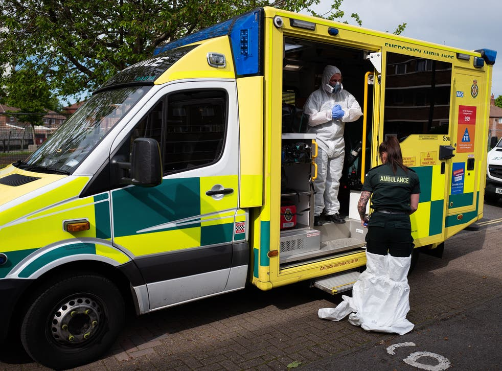 An ambulance crew remove their PPE after responding to a false alarm call for a heart attack in Portsmouth