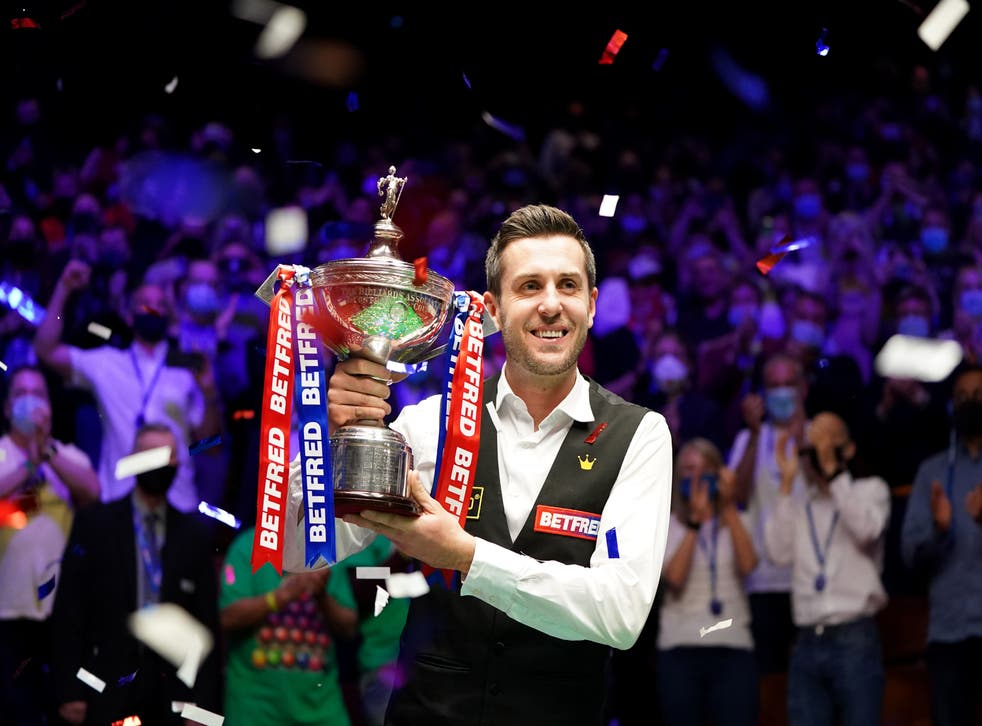Mark Selby celebrates with the World Snooker Championship trophy