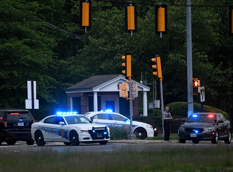 <p>Police cars are seen outside the CIA headquarters's gate after an attempted intrusion earlier in the day in Langley, Virginia, on May 3, 2021</p>