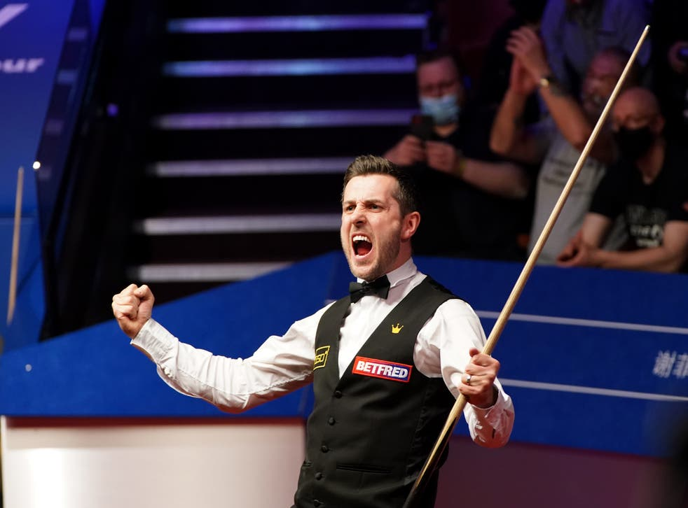 Mark Selby of England celebrates victory