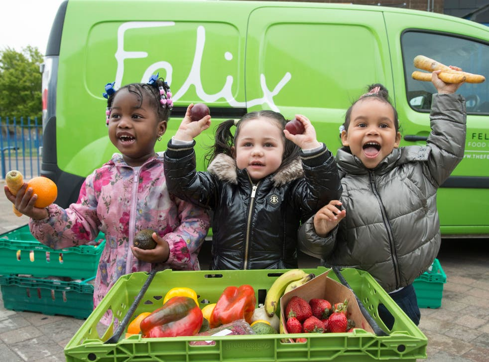<p>Dream, Aaliyah and Eva Rosie with fruit and veg provided by The Felix Project</p>