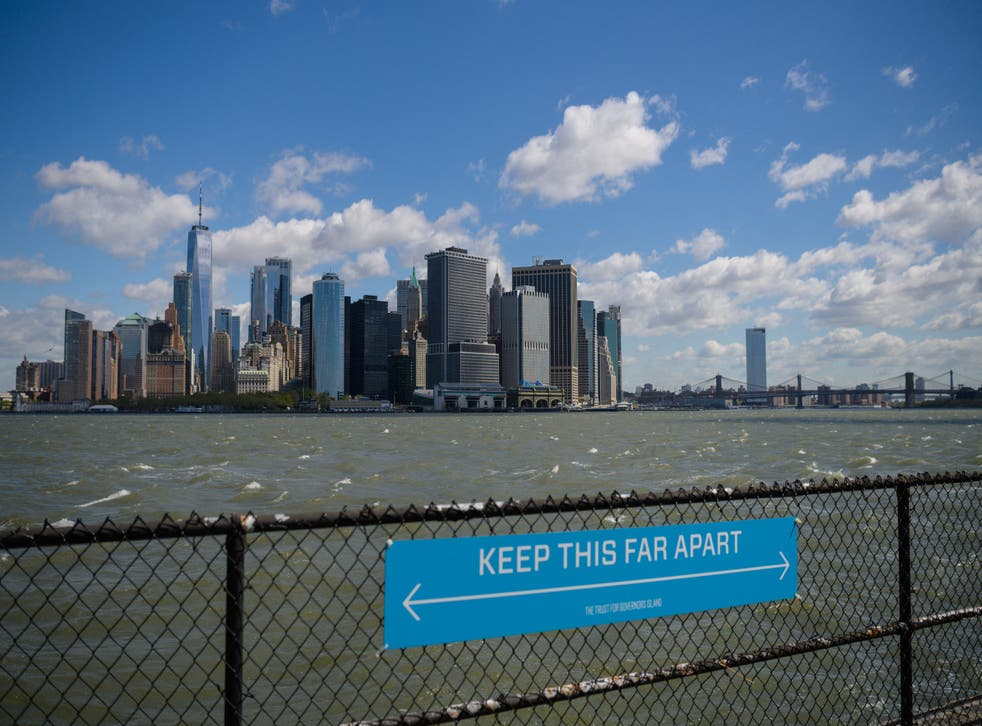 <p>A sign to promote social distancing is seen on Governors Island, New York</p>