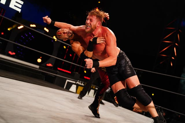 Jake Hager wrestles in a match against Brandon Cutler