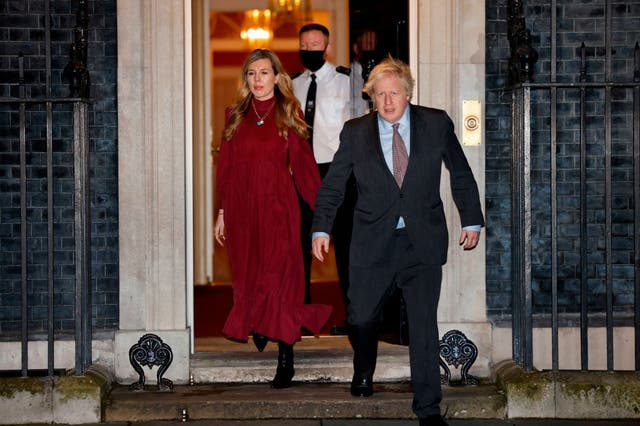 <p>Boris Johnson and his partner Carrie Symonds in Downing Street, where their lavish renovation took place</p>
