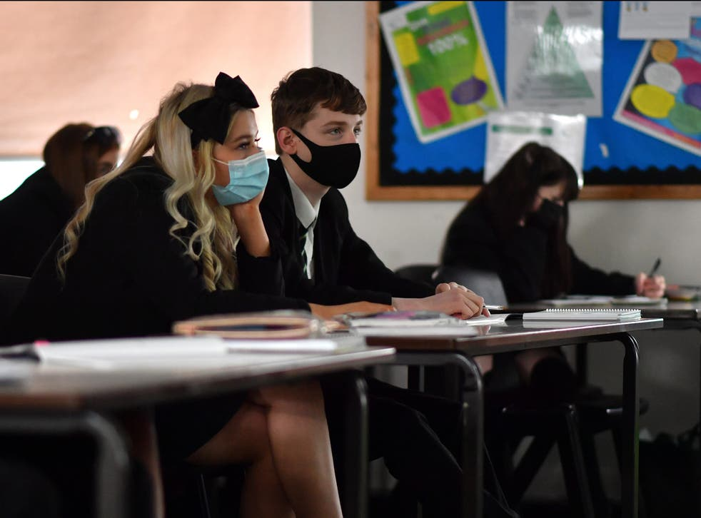 <p>The government has been urged not to drop advice over face masks in secondary school classrooms next month</p>
