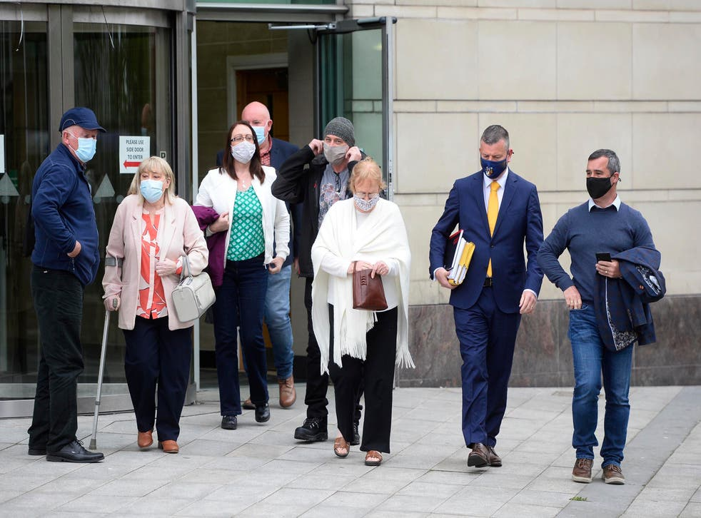 <p>Members of Joe McCann's family and their legal team leave Belfast Crown Court after the acquittal </p>