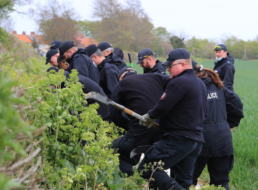 Police officers continue their search of fields close to the hamlet of Snowdown