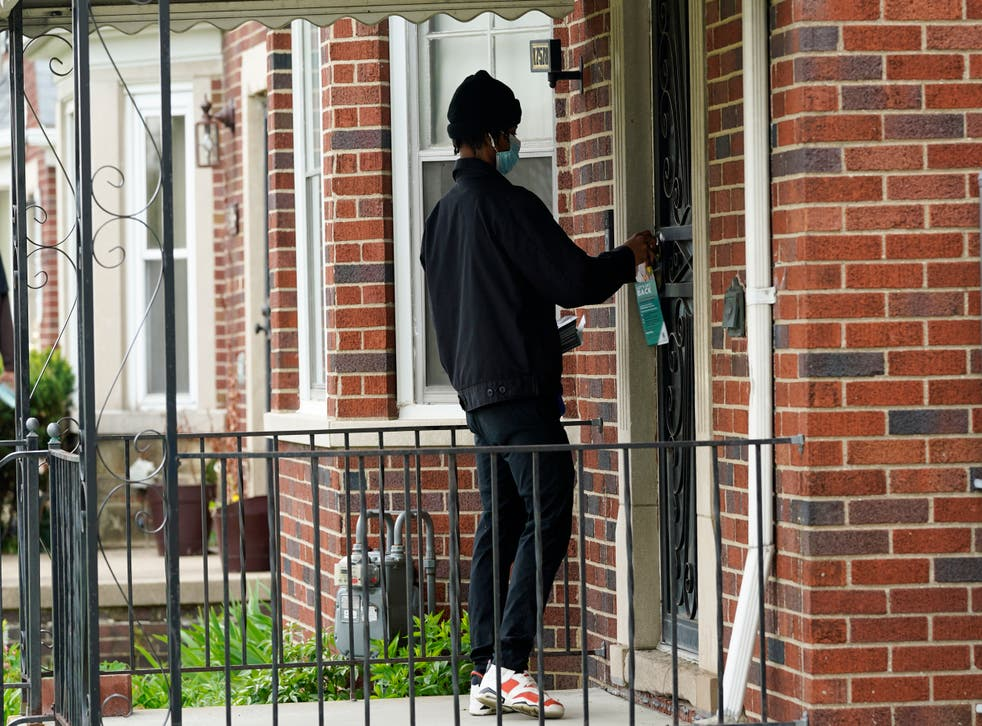 Virus Outbreak Detroit Door Knocking