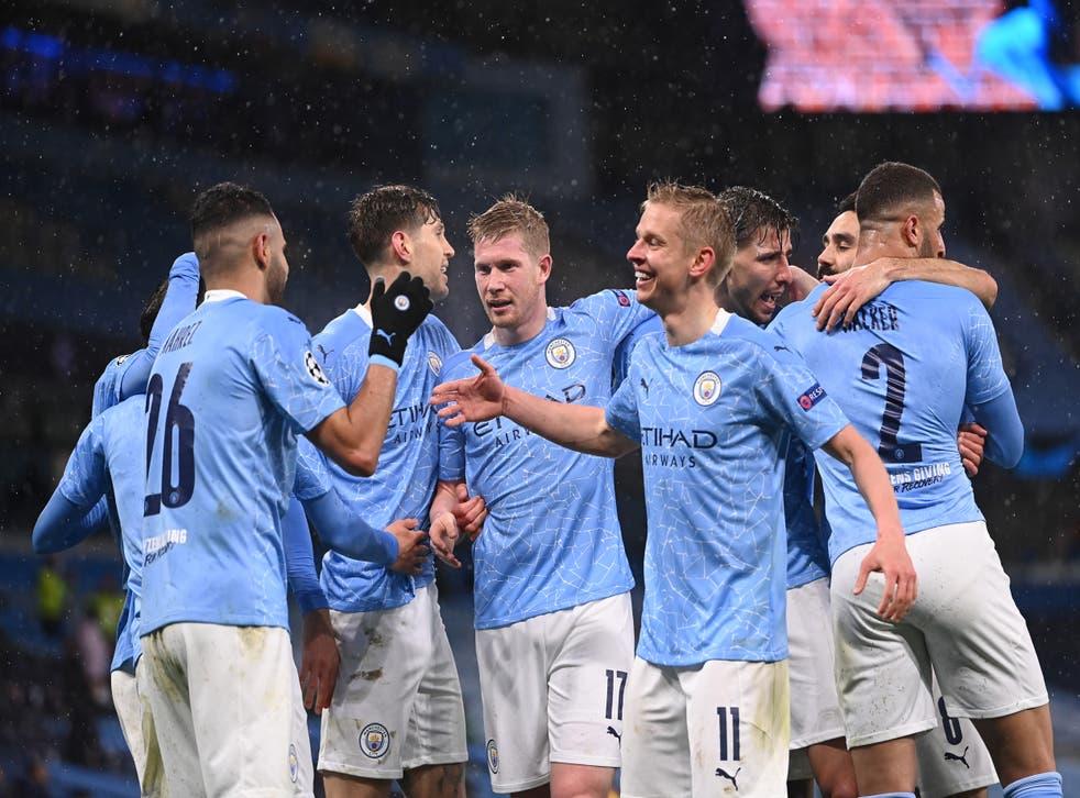 <p>Manchester City's players celebrate Riyad Mahrez's second goal</p>