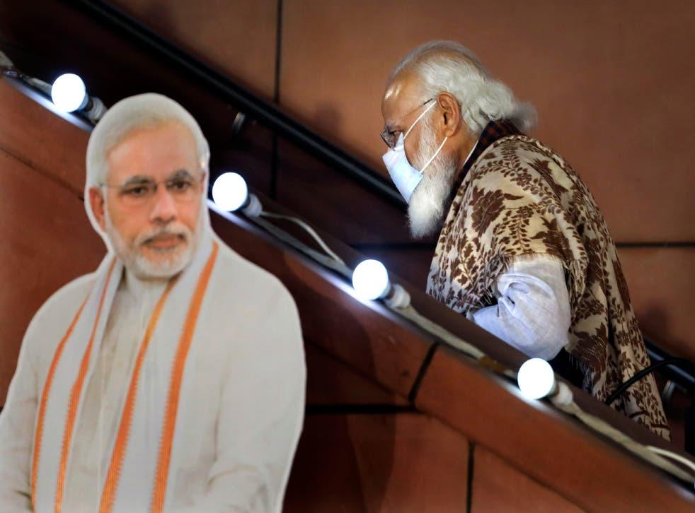 Virus Outbreak India Modi