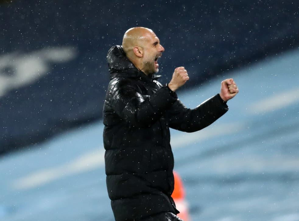 Pep Guardiola celebrates Man City's victory