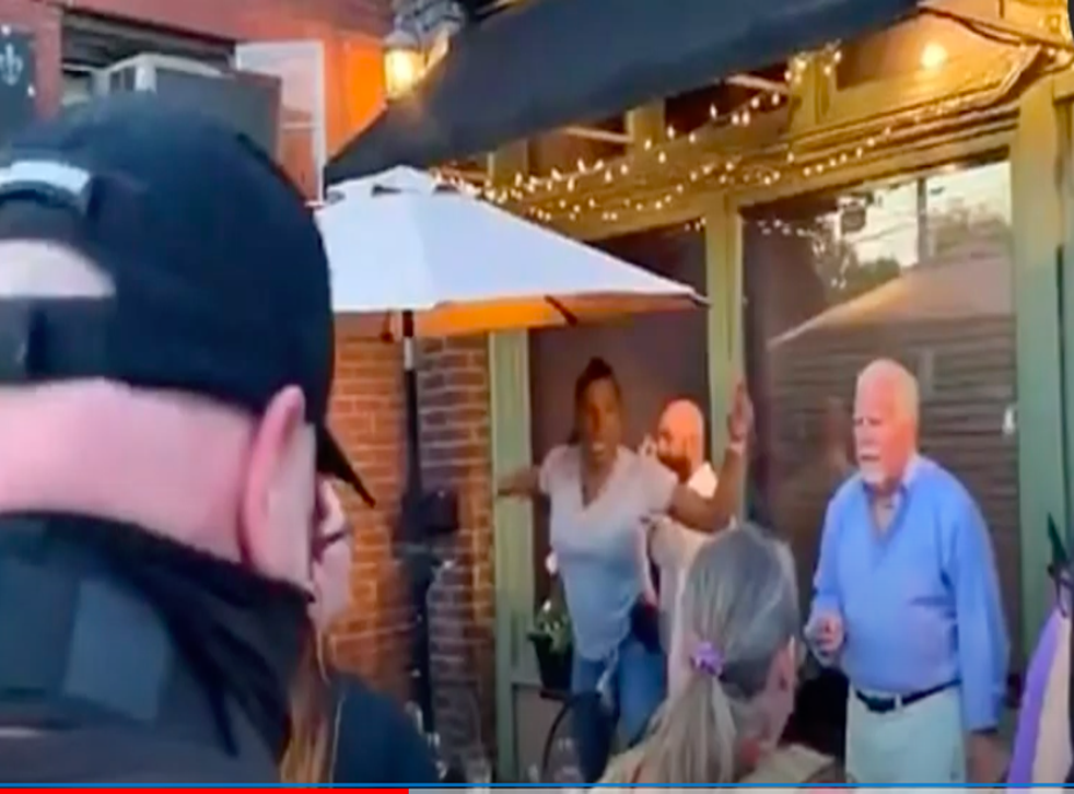 <p>Diner in Louisville wields a handgun at BLM protesters. Screengrab</p>