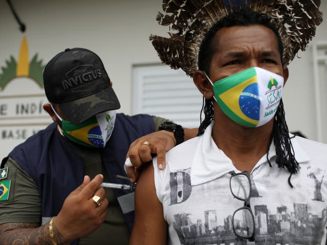 Healthcare workers have reportedly been confronted by crowds armed with bows and arrows while attempting to deliver the Covid-19 vaccine to an indigenous community in Brazil
