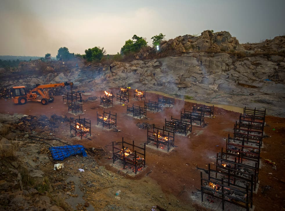<p> A crane places new biers in a disused granite quarry repurposed to cremate the dead due to Covid-19 on April 30, 2021 in Bengaluru, India</p>