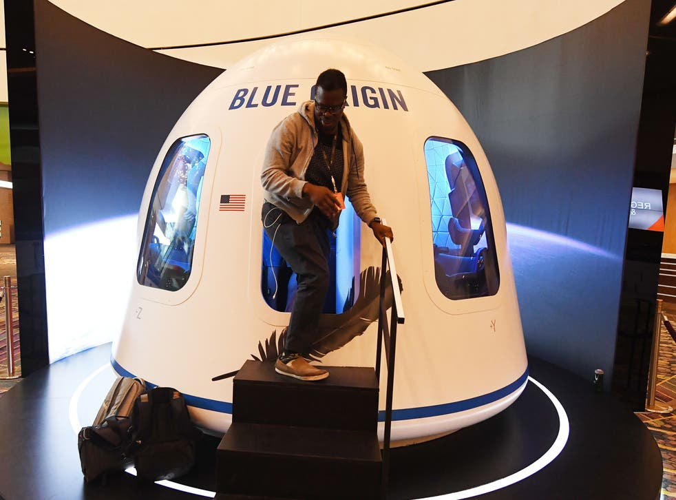 Participants leave the Blue Origin Space Simulator during the Amazon Re:MARS conference on robotics and artificial intelligence at the Aria Hotel in Las Vegas