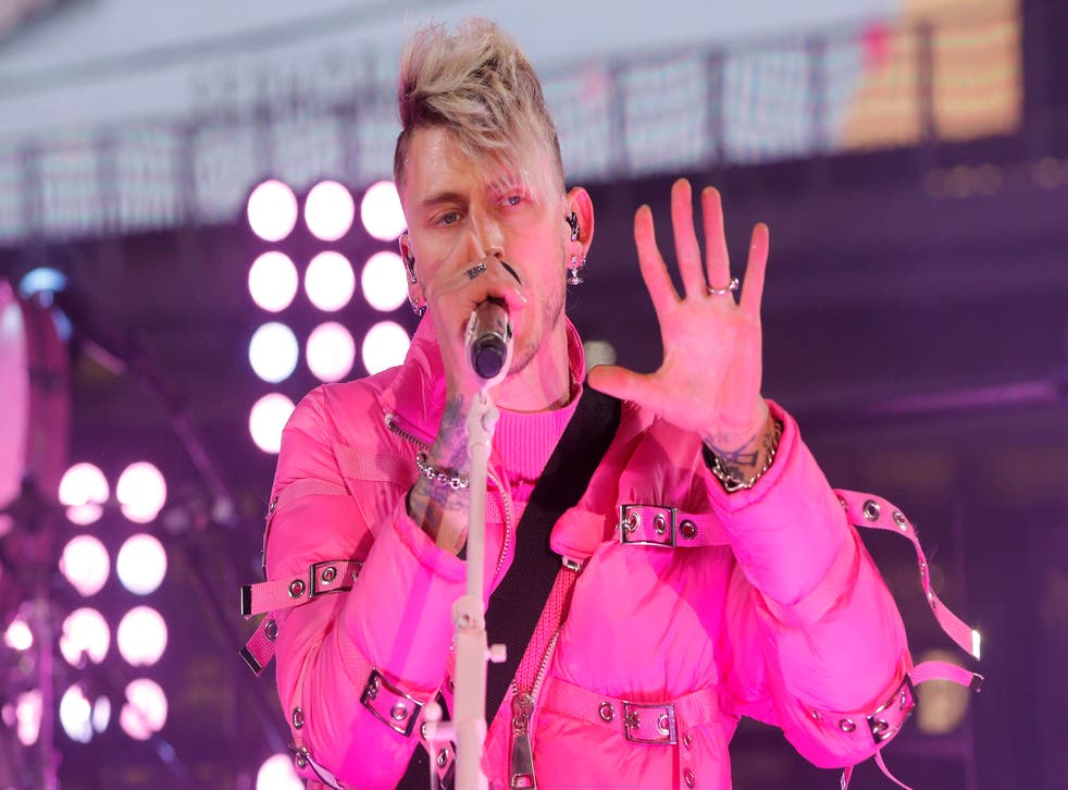 Singer Machine Gun Kelly performs in Times Square during New Year's Eve celebration