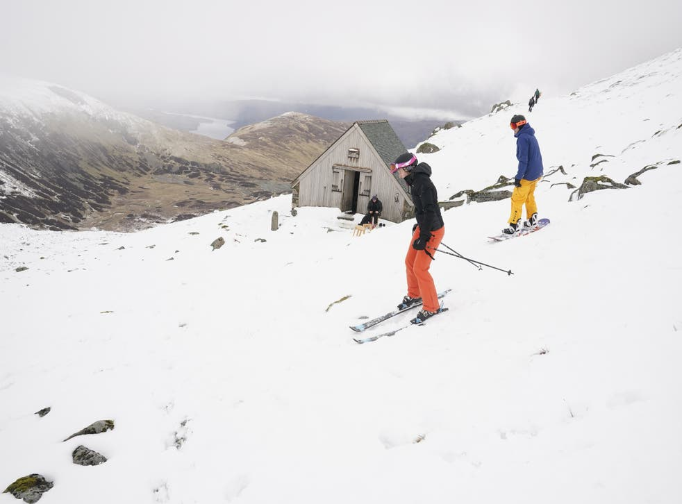 Skiers and snowboarders on Raise, near Helvellyn