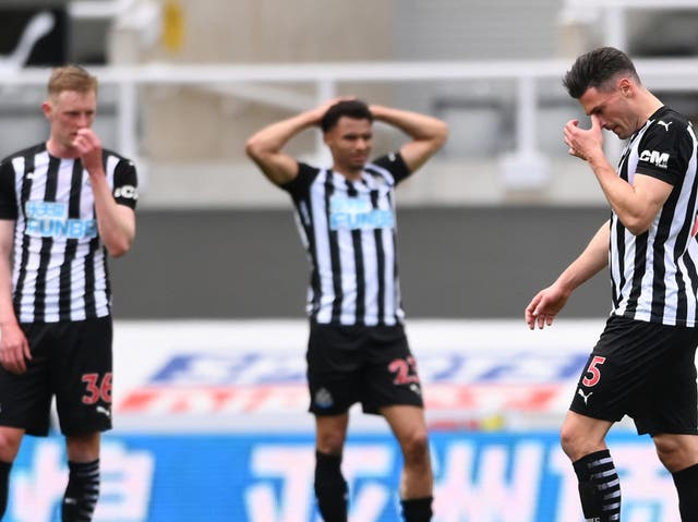 Newcastle players react to Fabian Schar's (right) red card against Newcastle