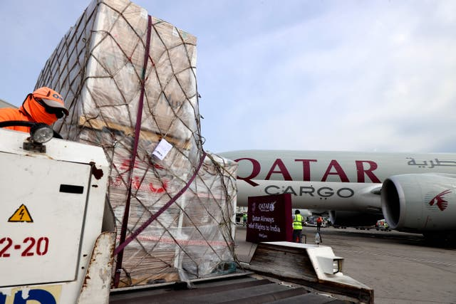 <p>Workers load 300 tonnes of medical aid to be flown in a three-flight cargo aircraft convoy directly to destinations in India</p>