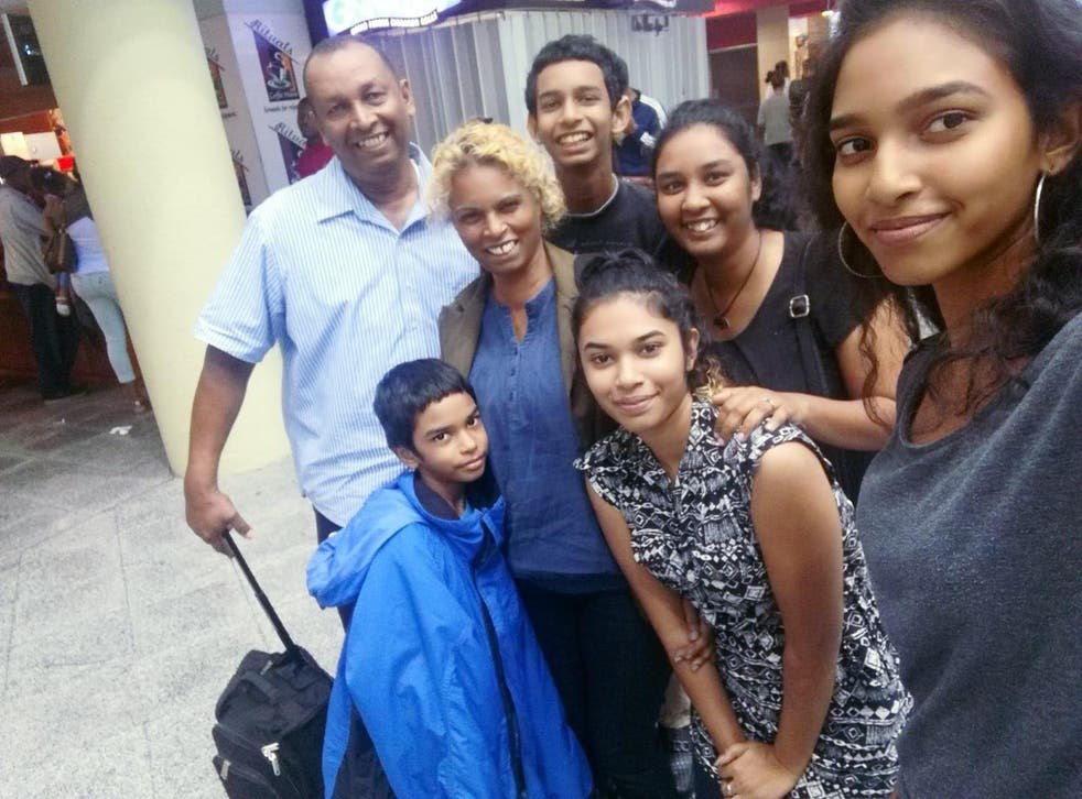 <p>Lynda Mahabir (second left) had hoped it would be a matter of months before her family would be able to join her when she left for the UK in October 2018 – but they are still apart</p>