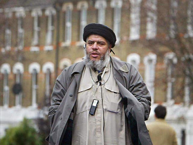 Imam Abu Hamza al-Masri addresses followers during Friday prayer in near Finsbury Park mosque in north London, in this 26 March 2004 file photo