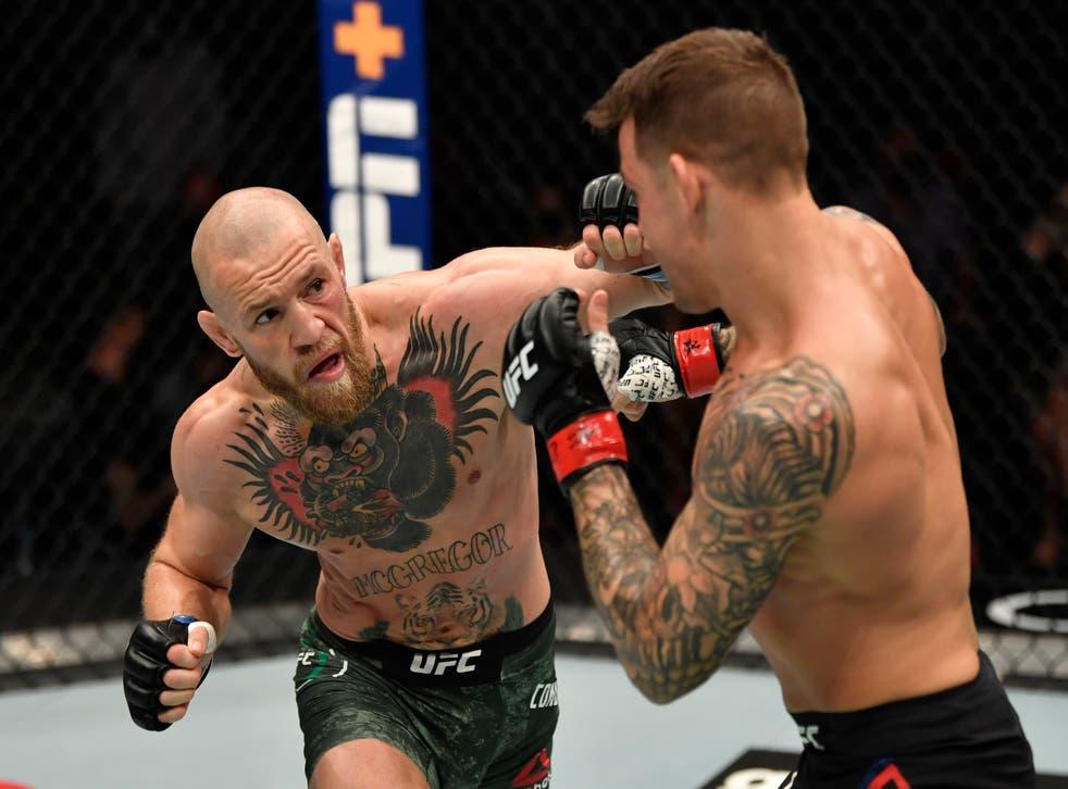 <p>Conor McGregor and Dustin Poirier during their UFC 257 clash</p>