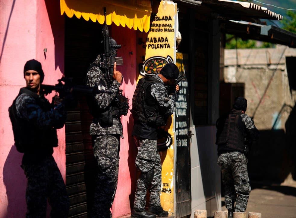 <p>Police officers carry out a raid against drug traffickers in the Jacarezinho area of Rio de Janeiro</p>
