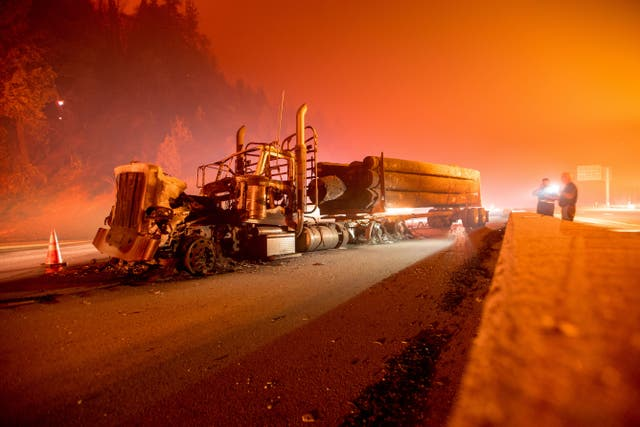 An abandoned smoldering truck after the Delta Fire tore through the area north of Redding, California and jumped the interstate on 5 September 2018