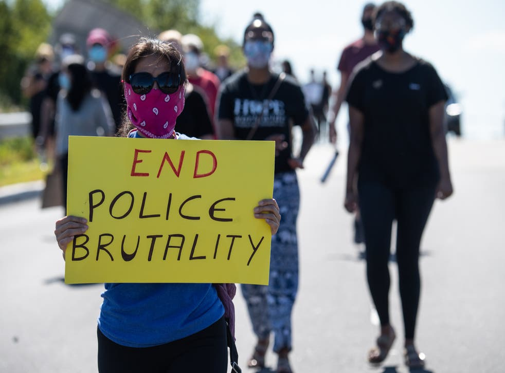<p>Protesters march in Bridgewater, New Jersey, on 13 June 2020 during a demonstration against police brutality and racism following the murder of George Floyd in Minneapolis on 25 May. </p>