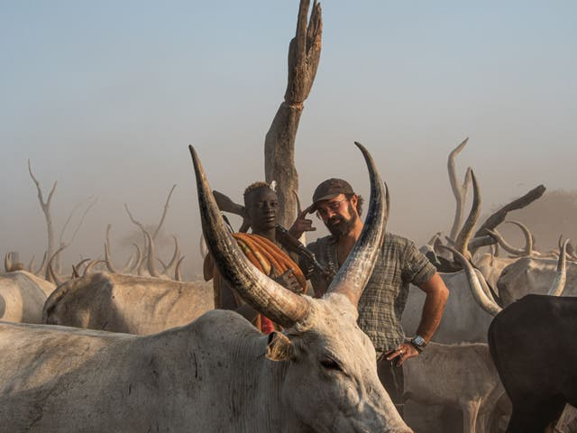 <p>Independent shareholder Evgeny Lebedev meets a herder at a cattle camp in South Sudan</p>