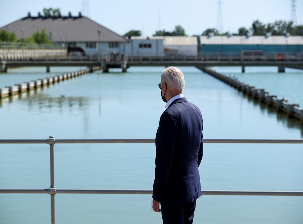 <p>Joe Biden looks out at the New Orleans Sewerage & Water Board's facility on 6 May.</p>