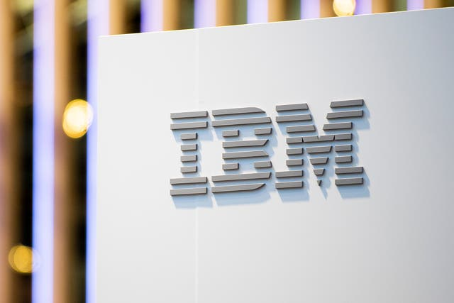 A logo sits illumintated outside the IBM booth on day 2 of the GSMA Mobile World Congress 2019