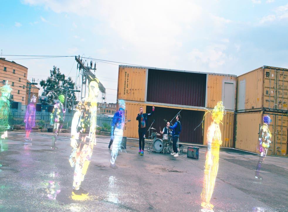 Coldplay perform among holograms