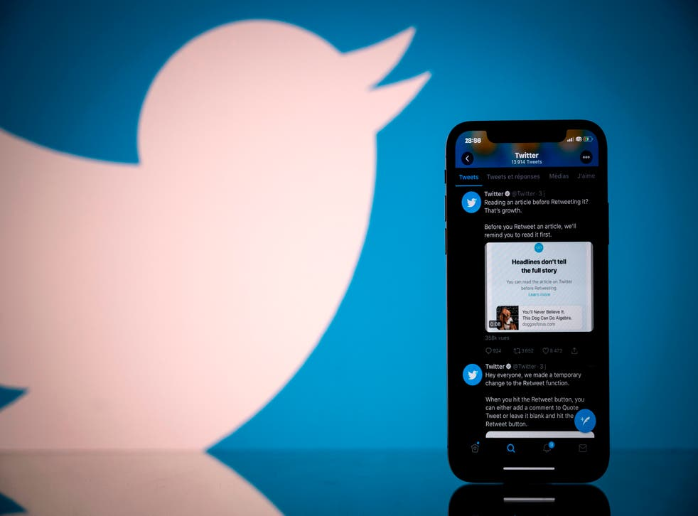 Logo of US social network Twitter displayed on the screen of a smartphone and a tablet