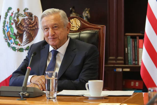 Handout photo released by the Mexican Presidency showing President Andres Manuel Lopez Obrador (L) during his virtual meeting with US Vice President Kamala Harris at the Palacio Nacional in Mexico City on May 07, 2021.