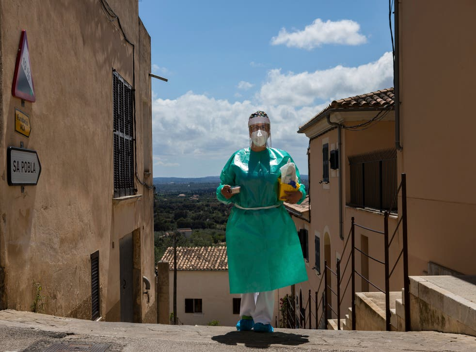 Virus Outbreak Spain Home Vaccinations Photo Gallery