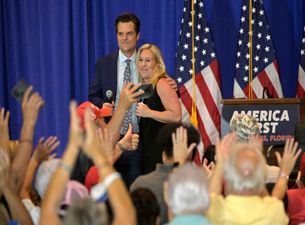 Republican representatives Matt Gaetz and Marjorie Taylor Greene hug after an 'America First' rally in Florida