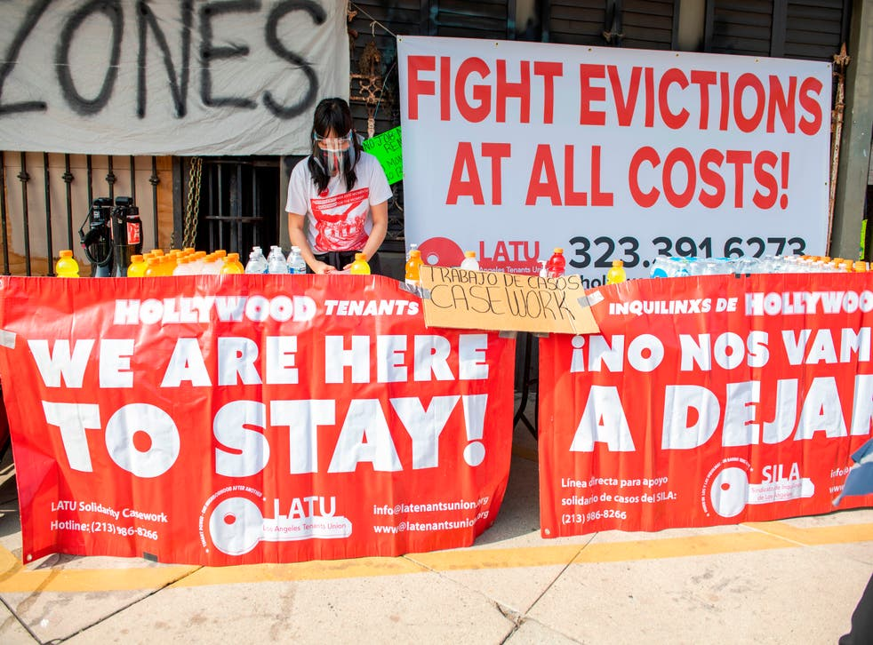 <p>Members of the Los Angeles Tenants Union protest against evictions and give out food for the homeless on February 8, 2021 in Hollywood, California. </p>