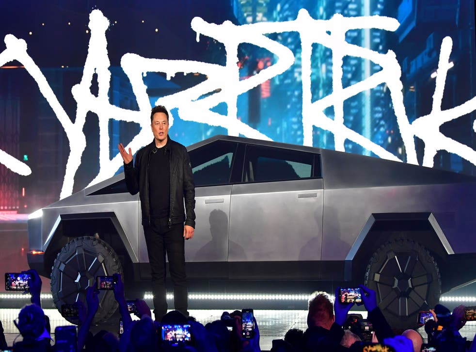 <p>Tesla co-founder and CEO Elon Musk introduces the newly unveiled all-electric battery-powered Tesla Cybertruck at Tesla Design Center in Hawthorne, California on November 21, 2019</p>