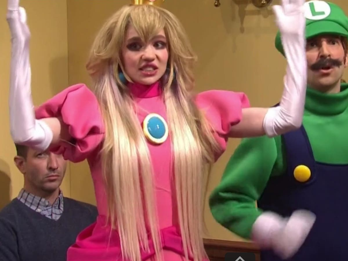 Grimes joins Elon Musk in SNL sketch as the Princess Peach to his Wario - The Independent