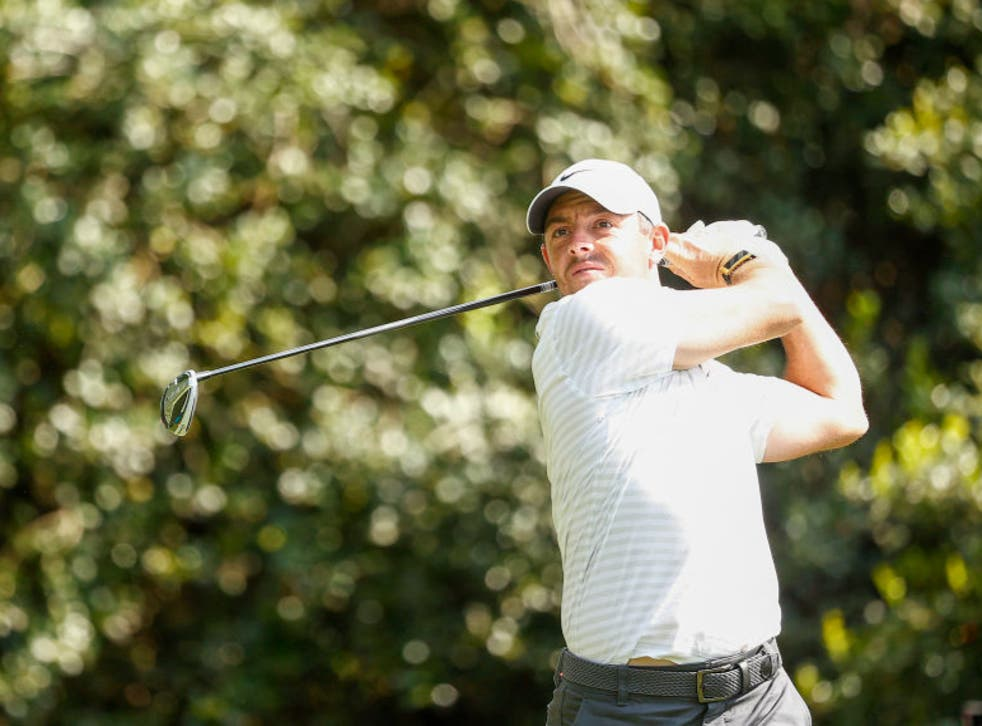 Rory McIlroy of Northern Ireland plays his shot from the 14th tee