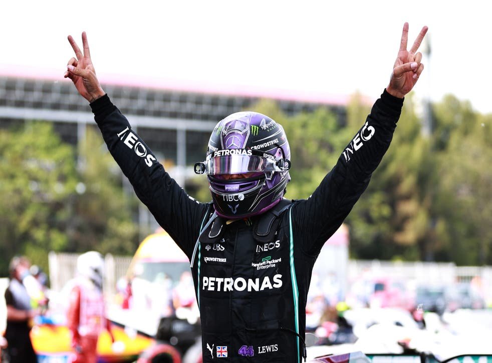 Lewis Hamilton celebrates clinching victory in Spain