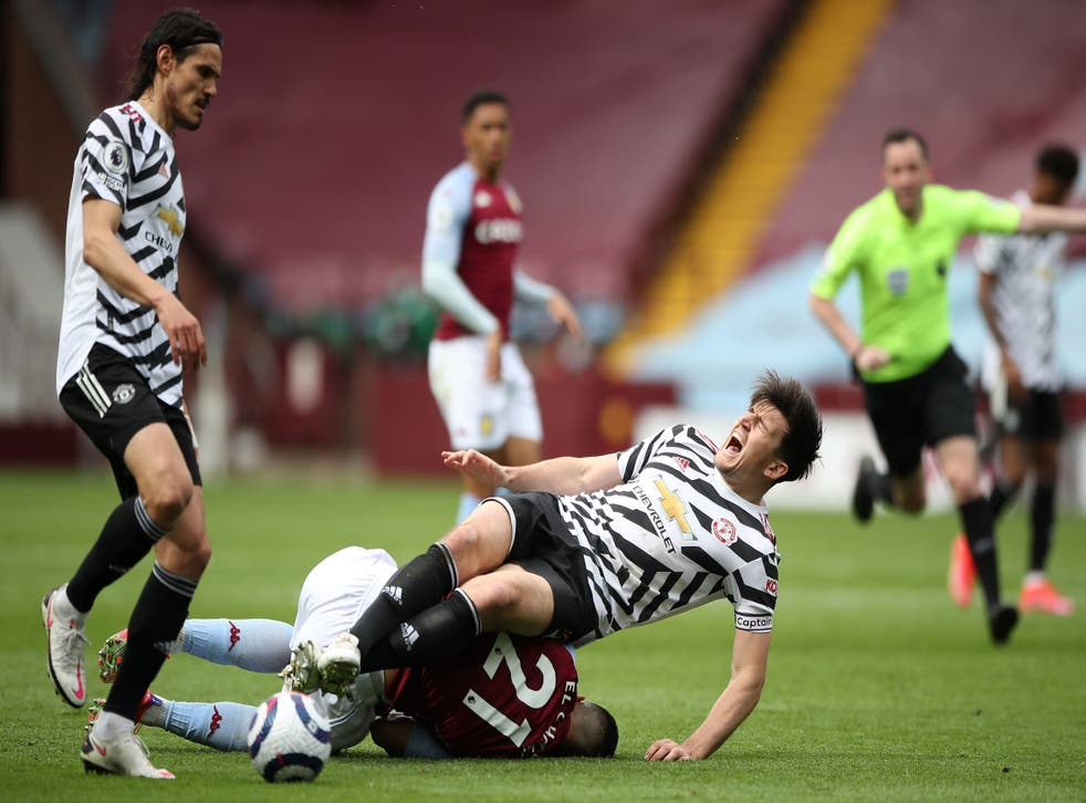 <p>Harry Maguire appeared to injure his left ankle at Villa Park</p>